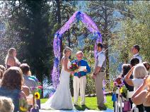 Ralph Fishburn, of Ralph's Regal Weddings, performing wedding at Higgins Point Park, Coeur d'Alene, Idaho.